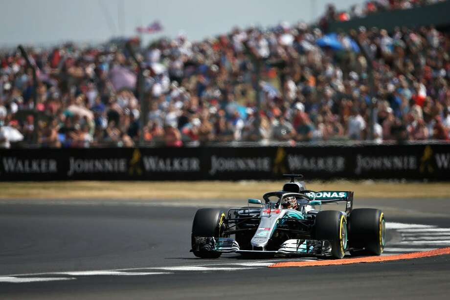 Defending Formula One champion Lewis Hamilton rumbles around his home track during qualifying for Sunday's Grand Prix of Great Britain at Silverstone. Photo: Charles Coates / Getty Images