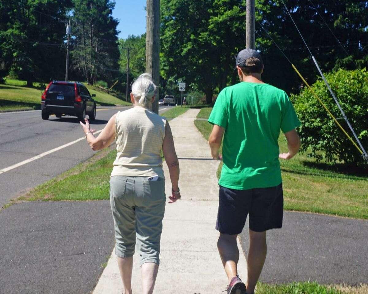 U.S. Sen. Chris Murphy walked with Berlin resident Pat Dutkiewicz in her neighborhood during his third annual walk across the state Saturday July 7, 2018.