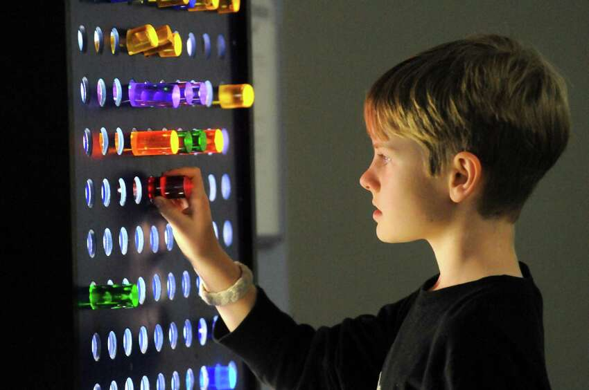 Nine-year-old Patrick Gilbert of Niskayuna plays with an LED display at CMOST children's museum on Saturday Nov. 7, 2015 in North Greenbush, N.Y. (Michael P. Farrell/Times Union)
