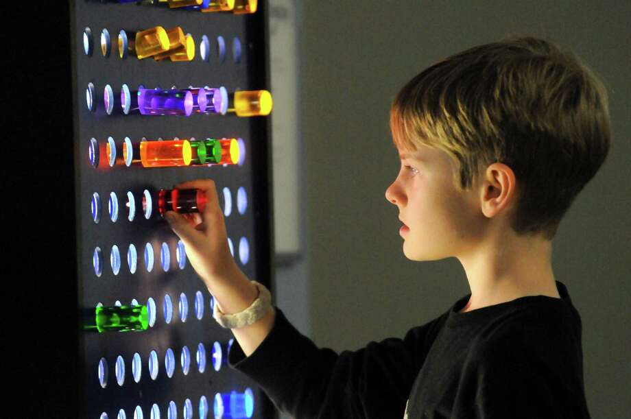 Nine-year-old Patrick Gilbert of Niskayuna plays with an LED display at CMOST children's museum on Saturday Nov. 7, 2015 in North Greenbush, N.Y. (Michael P. Farrell/Times Union) Photo: Michael P. Farrell / 00034109A