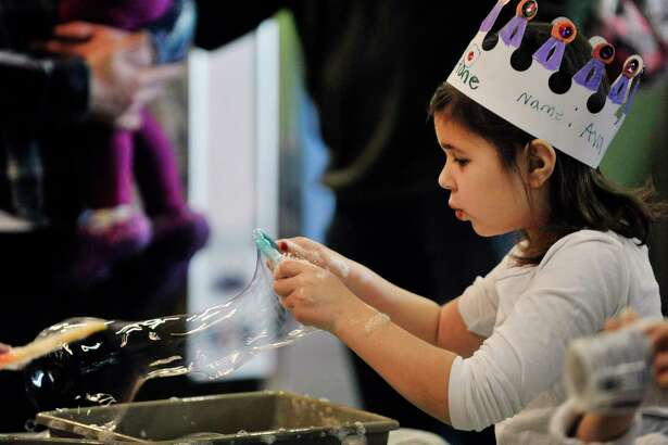 Ava Aiossa, 6, of Albany blows bubbles during a New Year's celebration at the CNSE Children's Museum of Science and Technology on Wednesday, Dec. 31, 2014, in North Greenbush, N.Y. The children and adults rang in the new year at 12 noon during the event at the museum. (Paul Buckowski / Times Union)