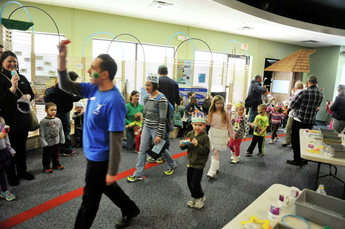 Children take part in a parade to ring in the new year during a New Years celebration at the CNSE Children's Museum of Science and Technology on Wednesday, Dec. 31, 2014, in North Greenbush, N.Y. The children and adults rang in the new year at 12 noon during the event at the museum. (Paul Buckowski / Times Union)