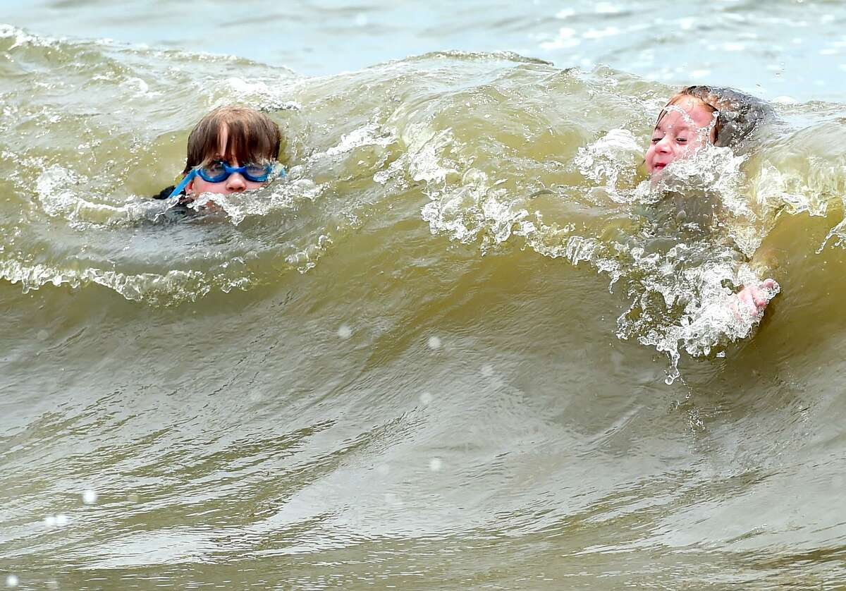 FILE PHOTO - Children swimming at East Beach at Hammonasset Beach State Park in Madison, Conn., on Monday, June 27, 2016.