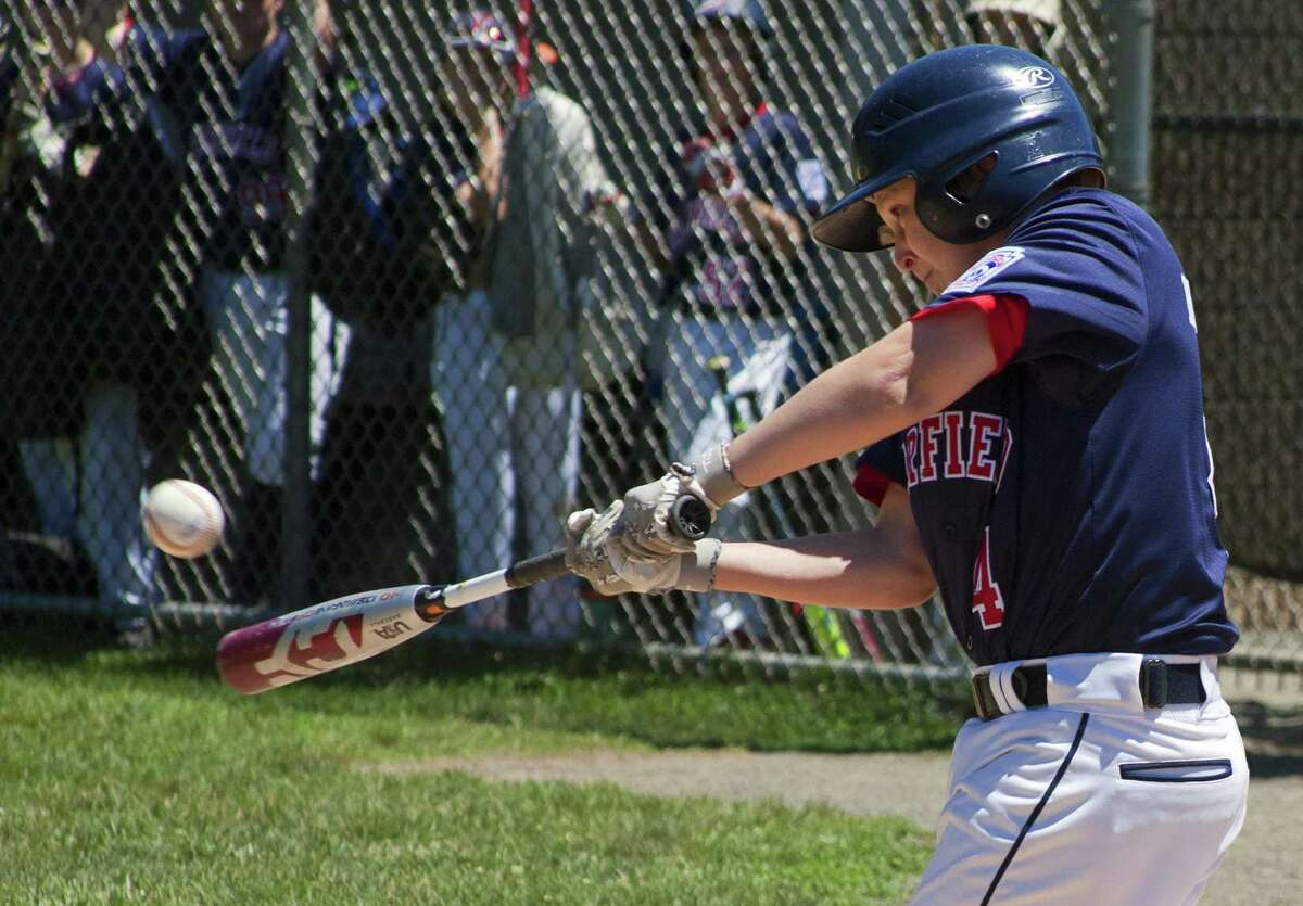 Fairfield National's Brendan Gagner gets a hit during District 2 little league baseball action against Fairfield American at Unity Park in Trumbull, Conn., on Saturday July 7, 2018.