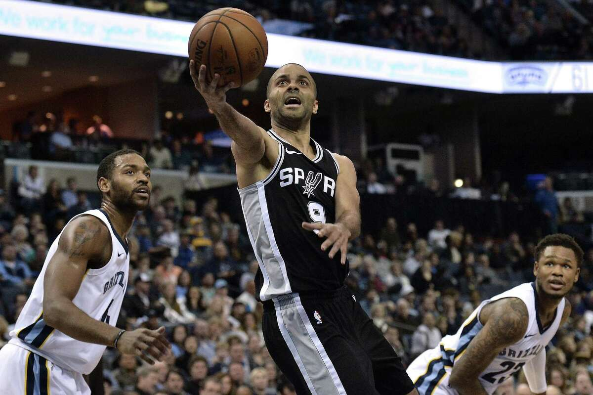 FILe - In this Jan. 24, 2018, file photo, San Antonio Spurs guard Tony Parker (9) shoots between Memphis Grizzlies forward Myke Henry (4) and guard Ben McLemore (23) during the second half of an NBA basketball game, in Memphis, Tenn. Tony Parker's time in San Antonio is over, after 17 seasons and four NBA championships. A person with knowledge of the negotiations says Parker has agreed to sign a two-year, $10 million deal with the Charlotte Hornets. The person spoke to AP on condition of anonymity Friday, July 6, 2018, because the deal has not been signed.(AP Photo/Brandon Dill, File)
