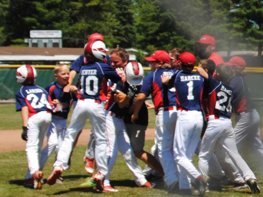 Fraternal Northwest players celebrate after their 12-11 come-from-behind walkoff win over Bullock Creek on Saturday in the first round of the Little League Baseball District 1 tournament at the Fraternal Northwest fields. Photo: Provided By Amy Ieuter