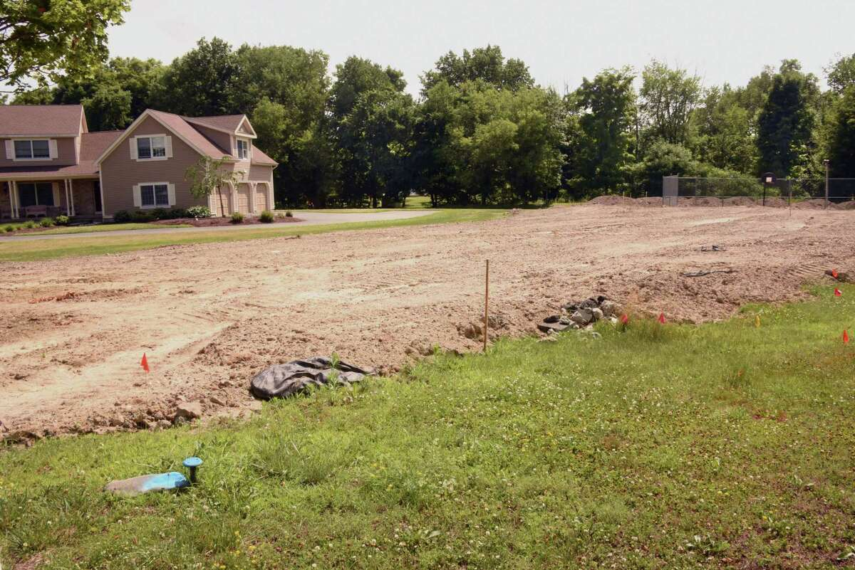 Fill is seen at the house next to North Greenbush Supervisor Louis Desso's house at 14 Stephen Drive on Tuesday, July 3, 2018 in Wynantskill, N.Y. The fill was arranged to be dumped for free by local developer David Mulinio. (Lori Van Buren/Times Union)