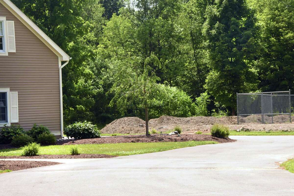 Fill is seen at the property next to North Greenbush Supervisor Louis Desso's house at 14 Stephen Drive on Tuesday, July 3, 2018 in Wynantskill, N.Y. The fill was arranged to be dumped for free by local developer David Mulinio. (Lori Van Buren/Times Union)
