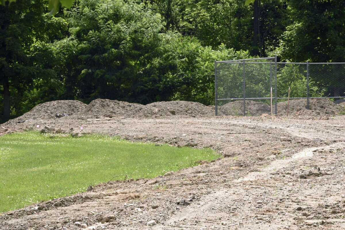 Fill is seen at the property next to North Greenbush Supervisor Louis Desso's house at 14 Stephen Drive on Tuesday, July 3, 2018 in Wynantskill, N.Y. Desso, who is giving the property to his son, said he had no property taking dirt for free from a developer with active business before the town. (Lori Van Buren/Times Union)