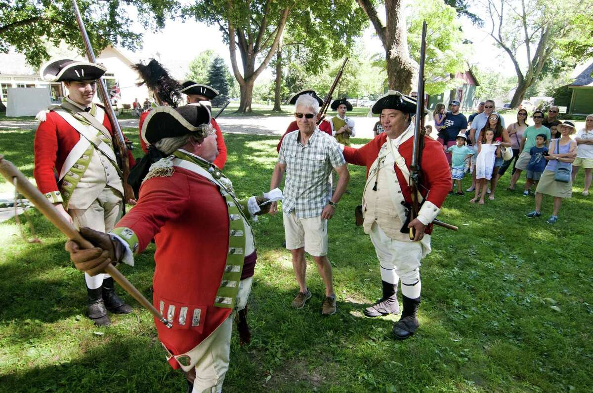 British soldier re-enactors from His Majesty's 54th Regiment of Foot take Ron. Blumenfeld, of Fairfield,