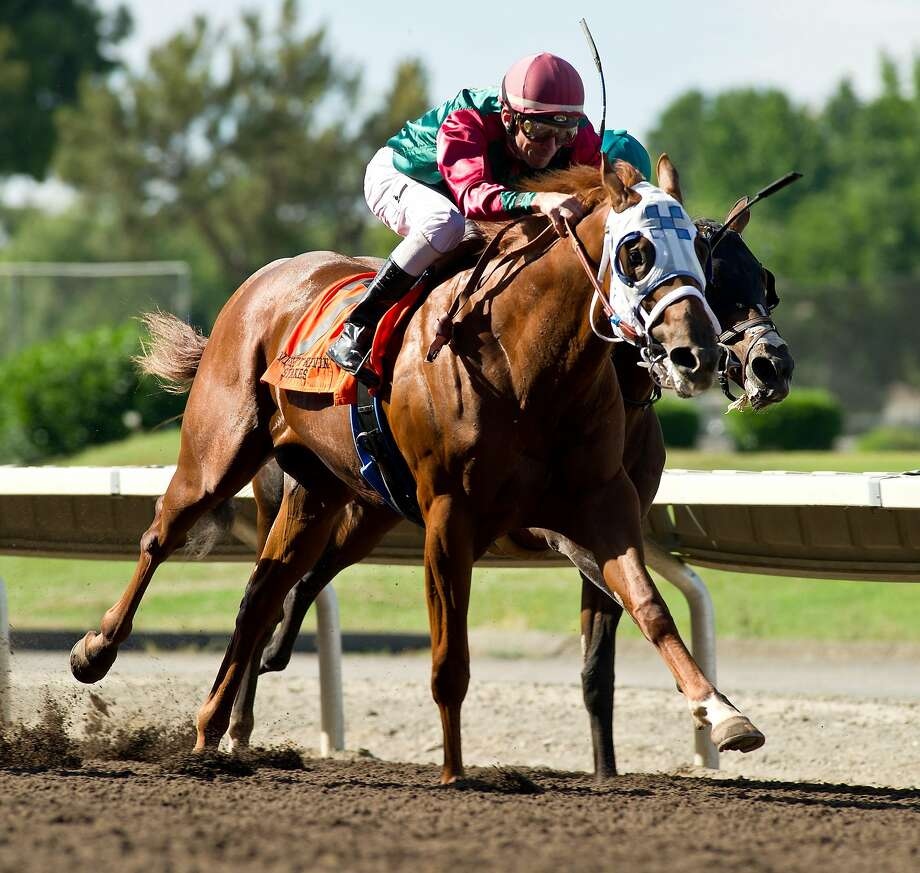 Luck's Royal Flush ridden by Stewart Elliott wins the $100,225 Everett Nevin Stakes at the Alameda County Fair in Pleasanton on Saturday. Photo: Shane Micheli, Shane Micheli/ Vassar Photography