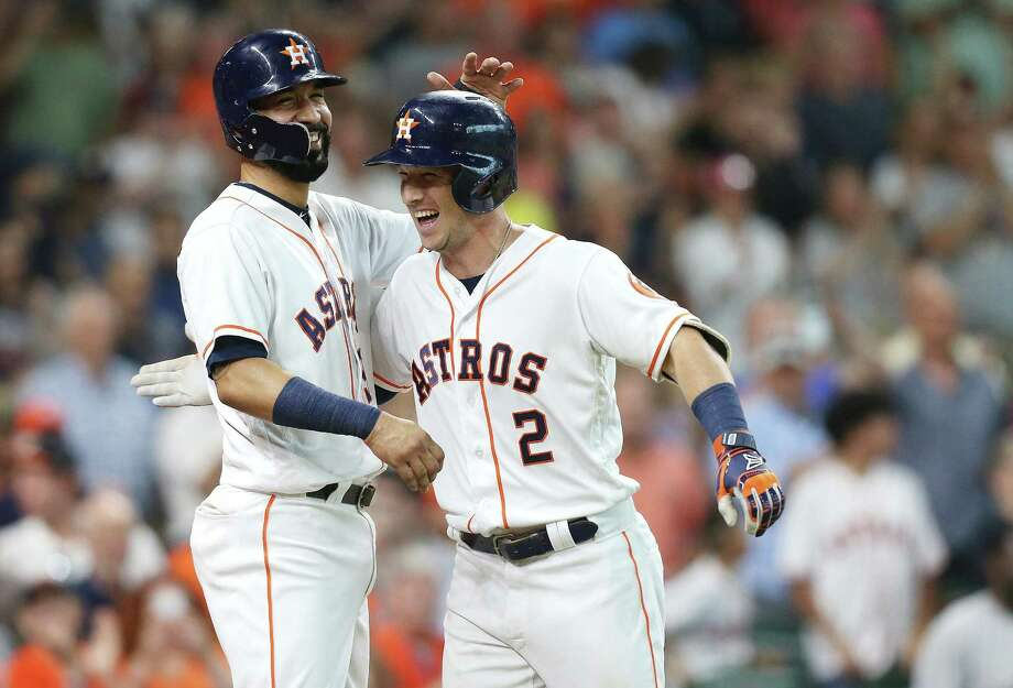 In what is becoming a familiar scene, Alex Bregman (2) is welcomed home by Marwin Gonzalez on Saturday after depositing a sixth-inning pitch into the Crawford Boxes for his 17th home run. Photo: Elizabeth Conley, Staff / Houston Chronicle / ©2018 Houston Chronicle
