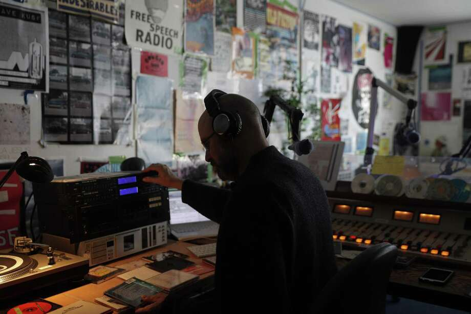 Board member and DJ Henry Wimmer during his show at the new home of KXSF (formerly KUSF) in San Francisco, Calif., on Wednesday, December 20, 2017. San Francisco Community Radio (SFCR) has been granted the call letters KXSF-LP by the FCC for its new broadcast radio station to begin operations in 2018. The station will be heard at 102.5 FM in the city of San Francisco -- the culmination of a seven-year process since the shutdown of KUSF 90.3 FM, driven by a group of former volunteers at KUSF joined with members of the community. Photo: Carlos Avila Gonzalez / The Chronicle / ONLINE_YES