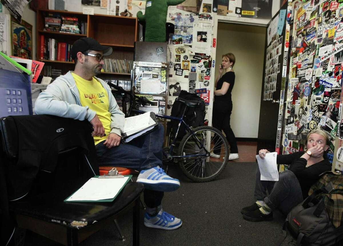KUSF volunteers Ethan Jenkins and Claudia Mueller and employee Miranda Morris are in disbelief after their popular public radio station on the University of San Francisco's campus was abruptly shut down in 2011.