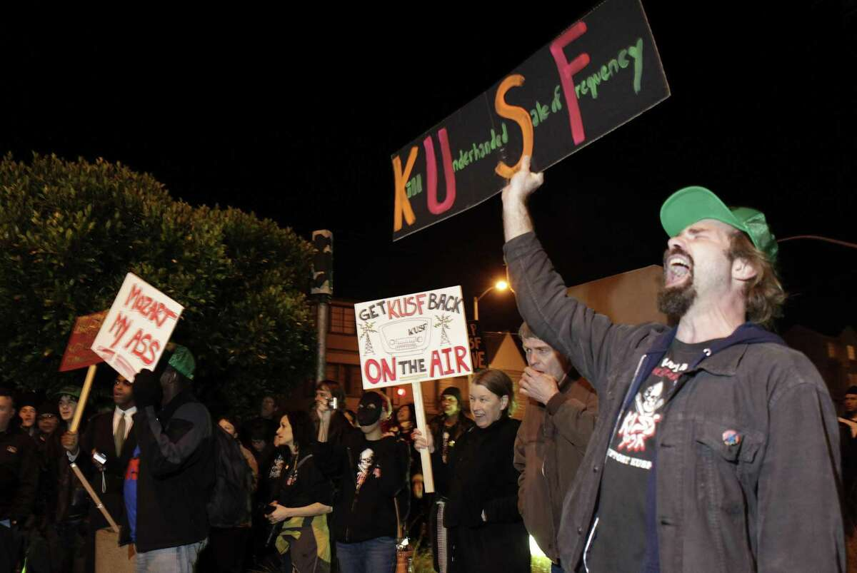 Top: DJ Henry Wimmer does his streaming show at the new home of KXSF. Right: Jay Jaworski (right), a KUSF volunteer, joins protest ers in 2011, objecting to the University of San Francisco's decision to shut down the station. Volunteers regrouped to establish KXSF, which will begin broadcasting in a few weeks.