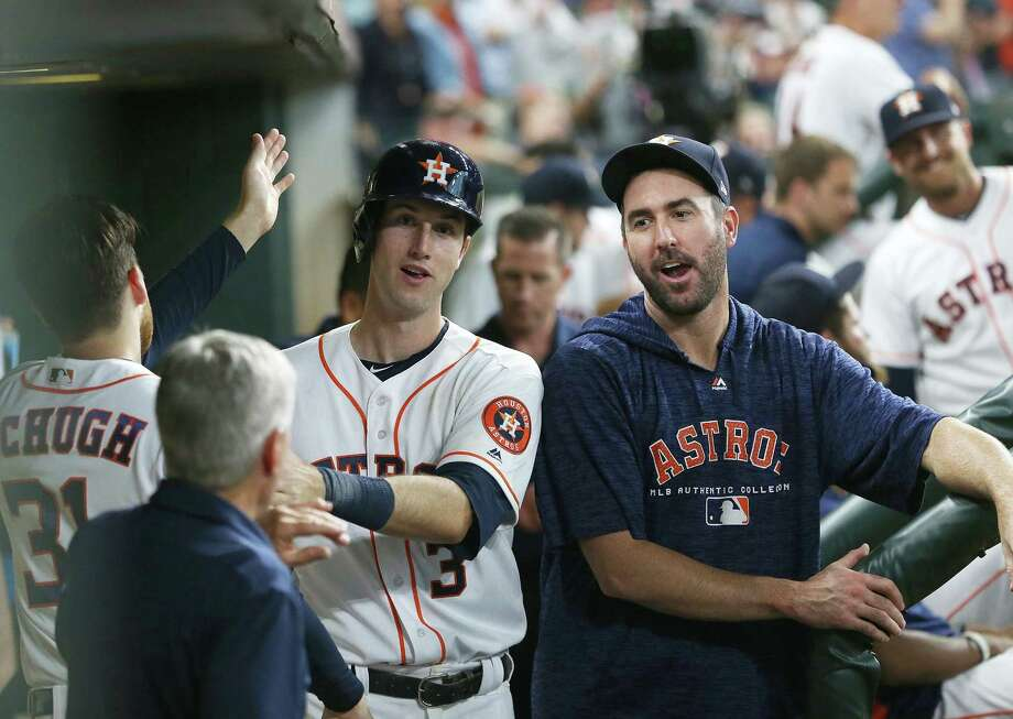 Kyle Tucker (3) was popular with Astros pitchers Collin McHugh (31) and Justin Verlander, right, after scoring his first big league run in the seventh inning of Saturday's win over the White Sox. Photo: Elizabeth Conley, Staff / Houston Chronicle / ©2018 Houston Chronicle