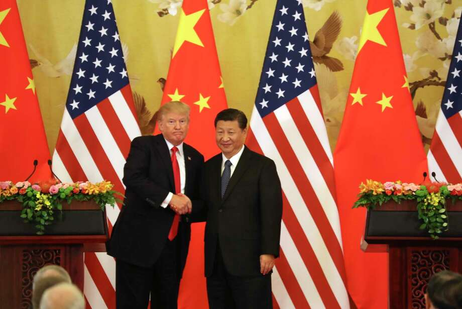 FILE - In this Nov. 9, 2017, file photo, U.S. President Donald Trump and Chinese President Xi Jinping shakes hands during a news conference at the Great Hall of the People in Beijing. Trump's trade battle with China will exacerbate relations with Beijing that are already fraying on several fronts as the U.S. takes a more confrontational stance and an increasingly powerful China stands its ground. (AP Photo/Andrew Harnik, File) Photo: Andrew Harnik / Copyright 2017 The Associated Press. All rights reserved.