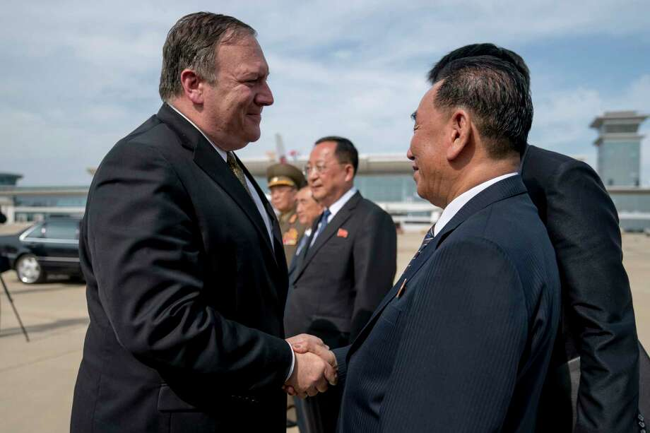 "U.S. Secretary of State Mike Pompeo, left, says goodbye to Kim Yong Chol, right, a North Korean senior ruling party official and former intelligence chief, before boarding his plane at Sunan International Airport in Pyongyang, North Korea, Saturday, July 7, 2018, to travel to Japan. Pompeo described two days of meetings with Chol as ""productive, good faith negotiations"" in the ongoing effort towards denuclearization, and plans have been set to discuss the process of repatriation of remains next week in Panmunjom. (AP Photo/Andrew Harnik, Pool) Photo: Andrew Harnik / Copyright 2018 The Associated Press. All rights reserved"