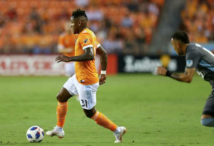 Houston Dynamo forward Romell Quioto (31) looks for an open teammate during first half of an MLS game against the Minnesota United at BBVA Compass Stadium Saturday, July 7, 2018, in Houston.