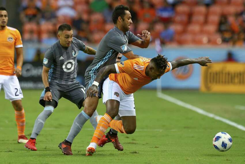Houston Dynamo forward Romell Quioto (31) is fouled by Minnesota United midfielder Ibson (7) during first half of an MLS game at BBVA Compass Stadium Saturday, July 7, 2018, in Houston.