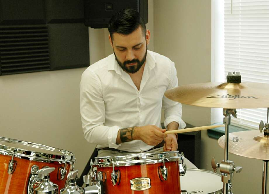 Jose Villa, instructor and co-founder of the Music Clubhouse, practices on the drums on Friday at the Lamar Bruni Vergara Boys and Girls Club of Laredo. Photo: Rebekah Rodriguez /Laredo Morning Times