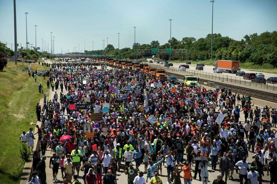 Thousands of anti-violence protesters pour into the inbound lanes of Interstate 94 known as the Dan Ryan Expressway Saturday, July 7, 2018 in Chicago.  The protesters shut down the interstate to draw attention to the city's gun violence and pressure public officials to do more to help neighborhoods hardest hit by it.  (Ashlee Rezin /Chicago Sun-Times via AP)  /Chicago Sun-Times via AP) Photo: Ashlee Rezin / Chicago Sun-Times