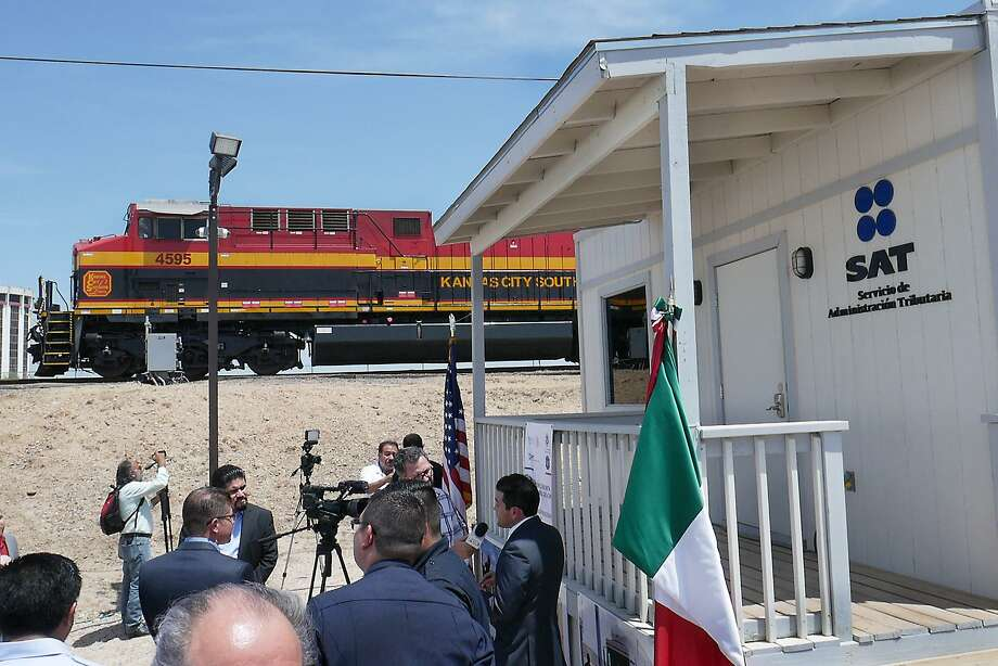 A Kansas City Southern engine pulls a northbound train after U.S. Customs and Border Protection (CBP), Servicio de Administración Tributaria (SAT)/Aduana Mexico and Kansas City Southern together with U.S. Rep. Henry Cuellar and Mayor Pete Saenz, participated in a ribbon-cutting ceremony for the unified rail cargo processing facility, Thursday, August 17, 2017. The facility will allow CBP officers and Mexican Customs officers to work collaboratively in the rail inspection environment. Photo: Cuate Santos / Laredo Morning Times / Laredo Morning Times