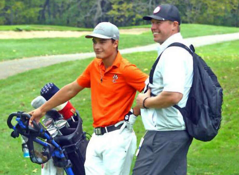 Edwardsville coach Adam Tyler talks with Ben Tyrrell last October between shots at the Class 3A state tournament at The Den at Fox Creek in Bloomington. Tyler is the 2017 Boys Golf Coach of the Year. Photo:       Scott Marion / Hearst Newspapers