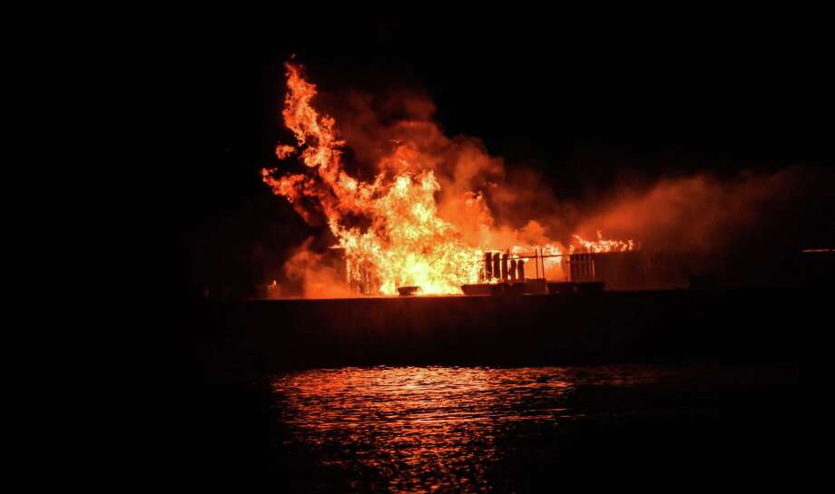 The barge on the Connecticut River setting off Middletown's fireworks show Saturday night caught fire. Photo: Dinesh Haryadi Photo
