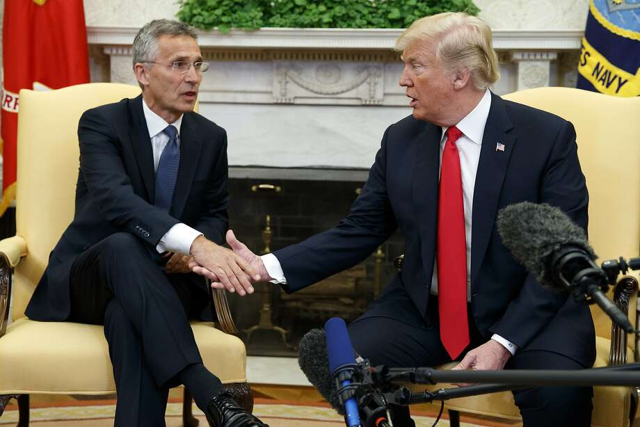 President Trump meets with NATO Secretary General Jens Stoltenberg in May in Washington. Trump's Europe trip will test strained bonds with some of the United States' closest allies. Photo: Evan Vucci / Associated Press