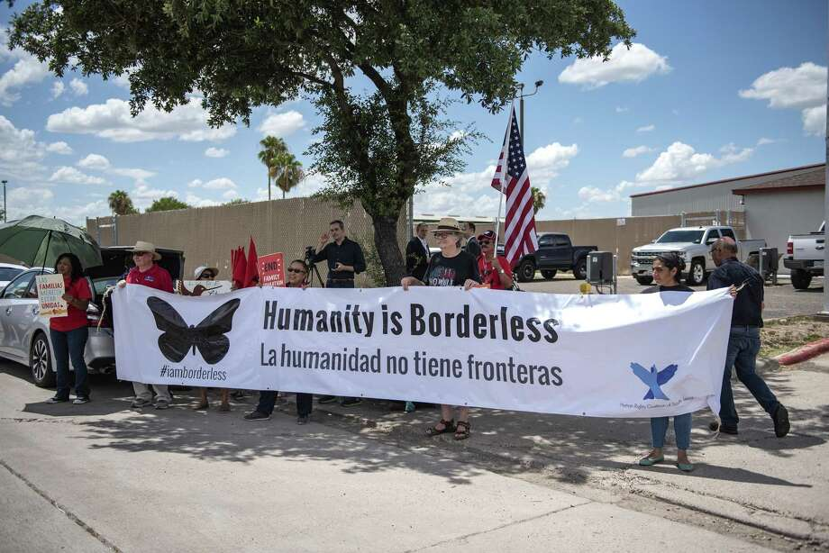 """Demonstrators hold a large banner that reads """"Humanity Is Borderless,"""" outside of a U.S. Border Patrol station in McAllen, Texas, June 17, 2018. Photo: Sergio Flores / Bloomberg / © 2018 Bloomberg Finance LP"""