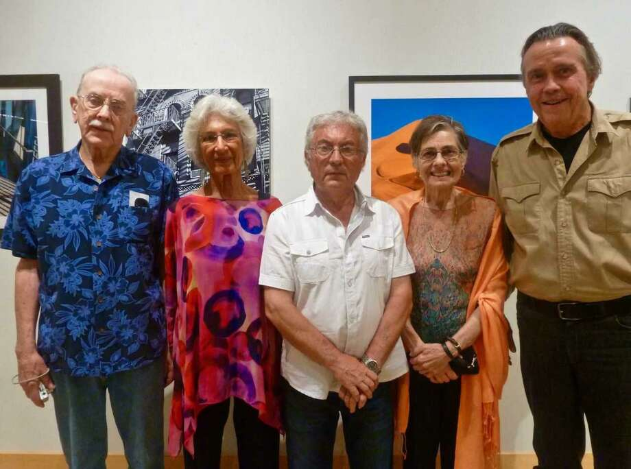 First place award-winning ASOG artists in the Flinn Gallery show are, from left: Tom Ecay, watercolor; Jo Ubogy, graphics; Sotiraq Kuqall, acrylic; Nina Cocchi, mixed media; and Greg Presley, photography. First place winners not pictured are Concetta E. Volpa, oil; and Myra Lehman, sculpture. Photo: Contributed /