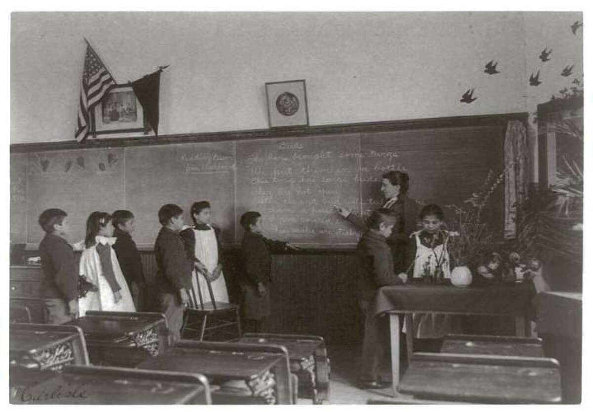 Elementary school class of Indian students with botanical specimens at United States Indian School, Carlisle, Pennsylvania, 1901.