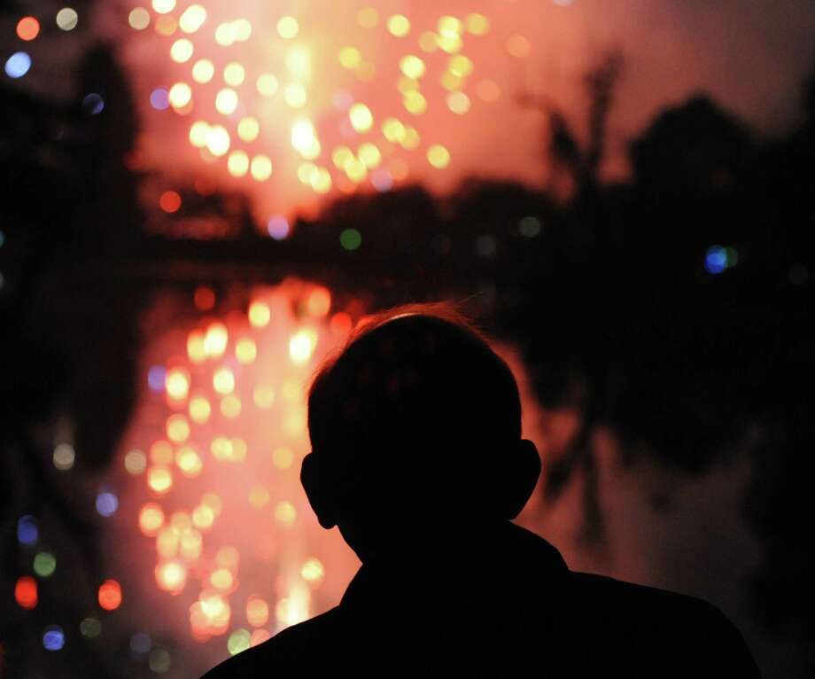 A man watches the colorful array of fireworks from the bridge at Binney Park in Old Greenwich, Conn. Saturday, July 7, 2018. Fireworks were on display from Binney Park and Greenwich Point Park Saturday night, featuring the Sound Beach Volunteer Fire Department Band at Binney Park and a DJ at Tod's Point. Photo: Tyler Sizemore / Hearst Connecticut Media / Greenwich Time