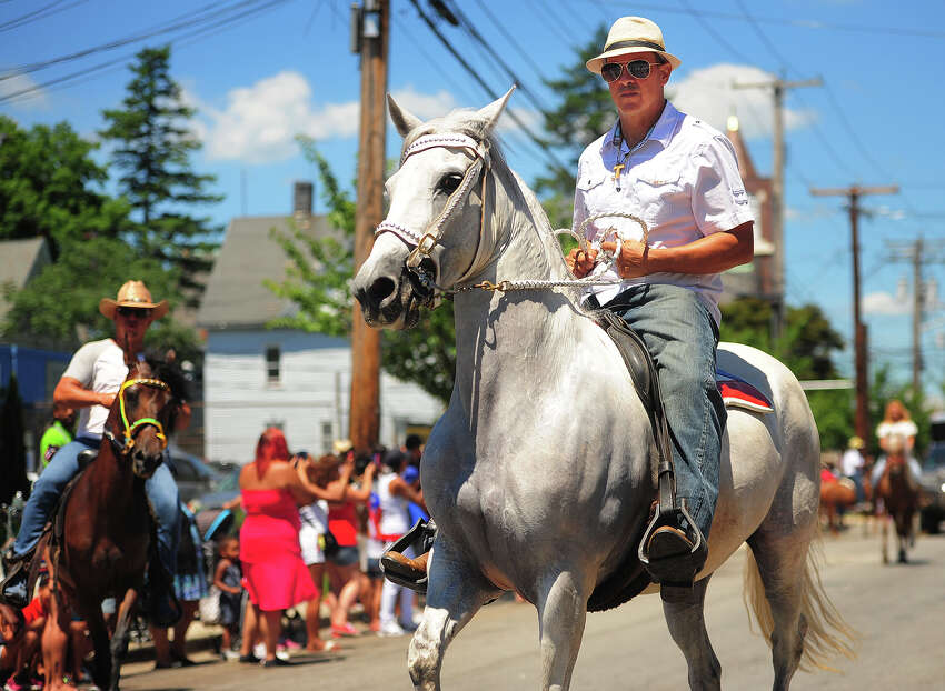 David Gonzalez, of Munson, MA, demonstrates his riding skills with the Paso Fino horses during the Annual Puerto Rican Day Parade on Park Avenue in Bridgeport, Conn. on Sunday, July 8, 2018. Gonzalez explained the Paso Fino translates to beautiful walkers in English.