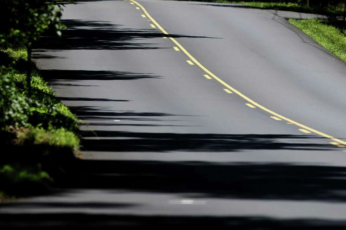 The painted lines along a stretch of recently paved Long Ridge Rd. has resulted in an increase in speeding and passing, in north Stamford, Conn. on Sunday, July 8, 2018. The lines are more visible, and neighbors say cars have become more aggressive.