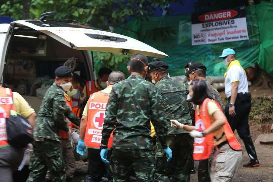 """In this handout photo taken and released by Chiang Rai Public Relations Office on July 8, 2018 shows Thai soldiers and paramedics assist a rescued boy on a stretcher to an ambulance in Tham Luang cave area after divers evacuated some of the 12 boys and their coach trapped in the cave in Khun Nam Nang Non Forest Park in the Mae Sai district on July 8, 2018. Foreign elite divers and Thai Navy SEALS on July 8 began the extremely dangerous operation to extract the 12 boys and their football coach as they raced against time, with imminent monsoon rains threatening more flooding that would doom the rescue operation. / AFP PHOTO / CHIANG RAI PUBLIC RELATIONS OFFICE / Handout / XGTY - RESTRICTED TO EDITORIAL USE - MANDATORY CREDIT """"AFP PHOTO / CHIANG RAI PUBLIC RELATIONS OFFICE"""" - NO MARKETING NO ADVERTISING CAMPAIGNS - DISTRIBUTED AS A SERVICE TO CLIENTSHANDOUT/AFP/Getty Images Photo: HANDOUT, AFP/Getty Images"""