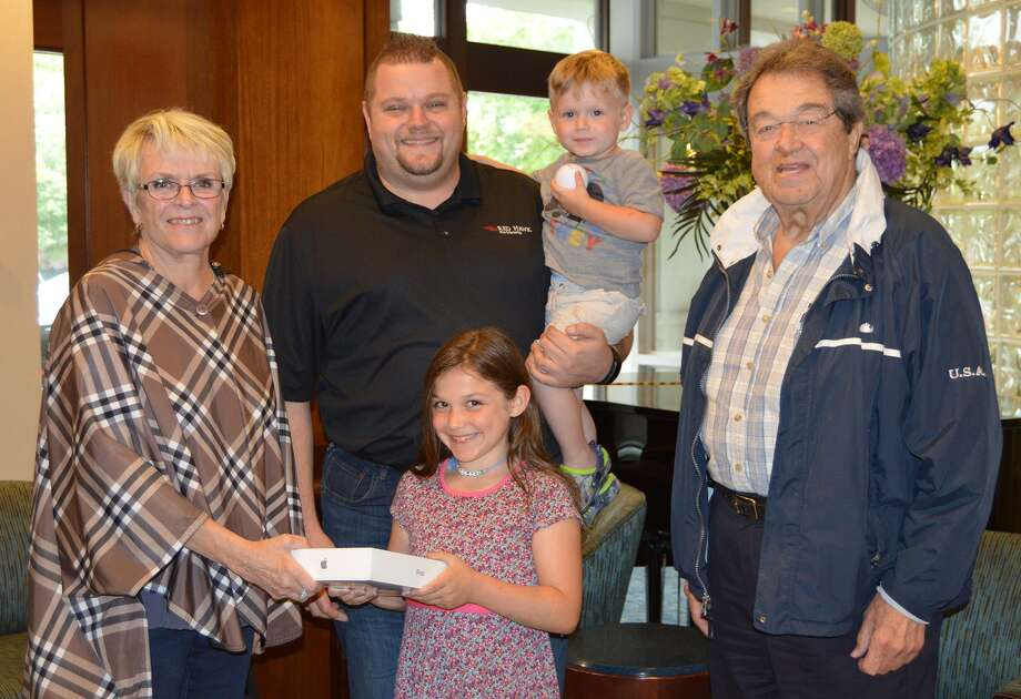 HiM Founder Frank  Michaud, right, and his wife Judy, left, present the grand prize iPad 6  to Robert Klein and his children, Ryder and Cameron, front. Photo: Contributed / Griffin Hospital
