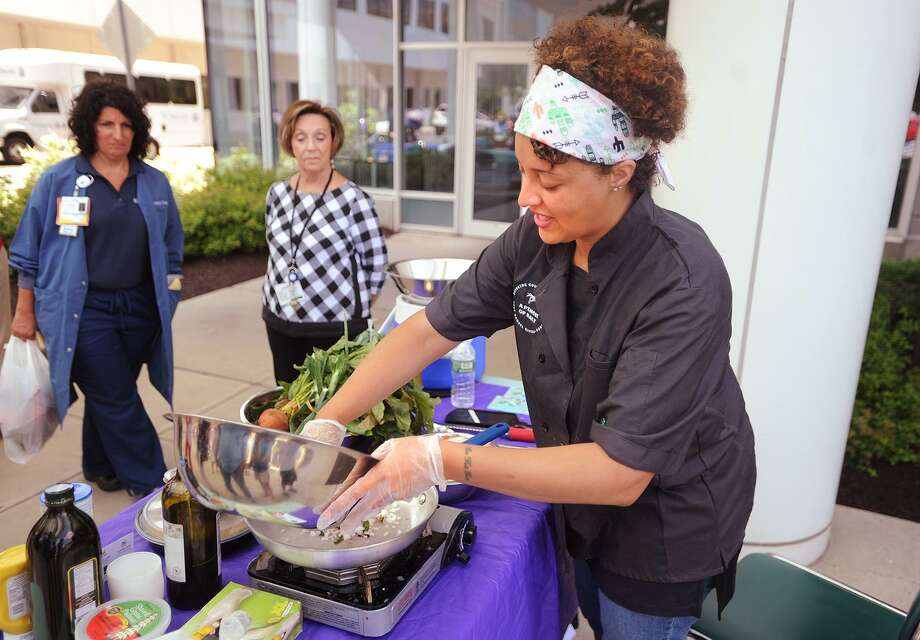 Chef Raquel Rivera-Pablo prepares a quinoa salad utilizing fresh beets, greens, and other vegetables during a cooking demonstration at the weekly farmers market at St. Vincent's Medical Center in Bridgeport, Conn. on Tuesday, July 18, 2017. River-Pablo will host a new series of demos outside the hospital, the first of which will take place Tuesday, July 10, 2018. Photo: Brian A. Pounds / Hearst Connecticut Media / Connecticut Post