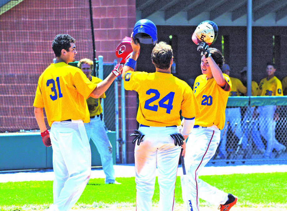 Post 199's Cole Hampton, right, is congratulated by teammates Nick Yates, left, and Reid Hendrickson after hitting a three-run homer in the bottom of the fourth inning during Sunday's game against Harrisburg at Alton High School.