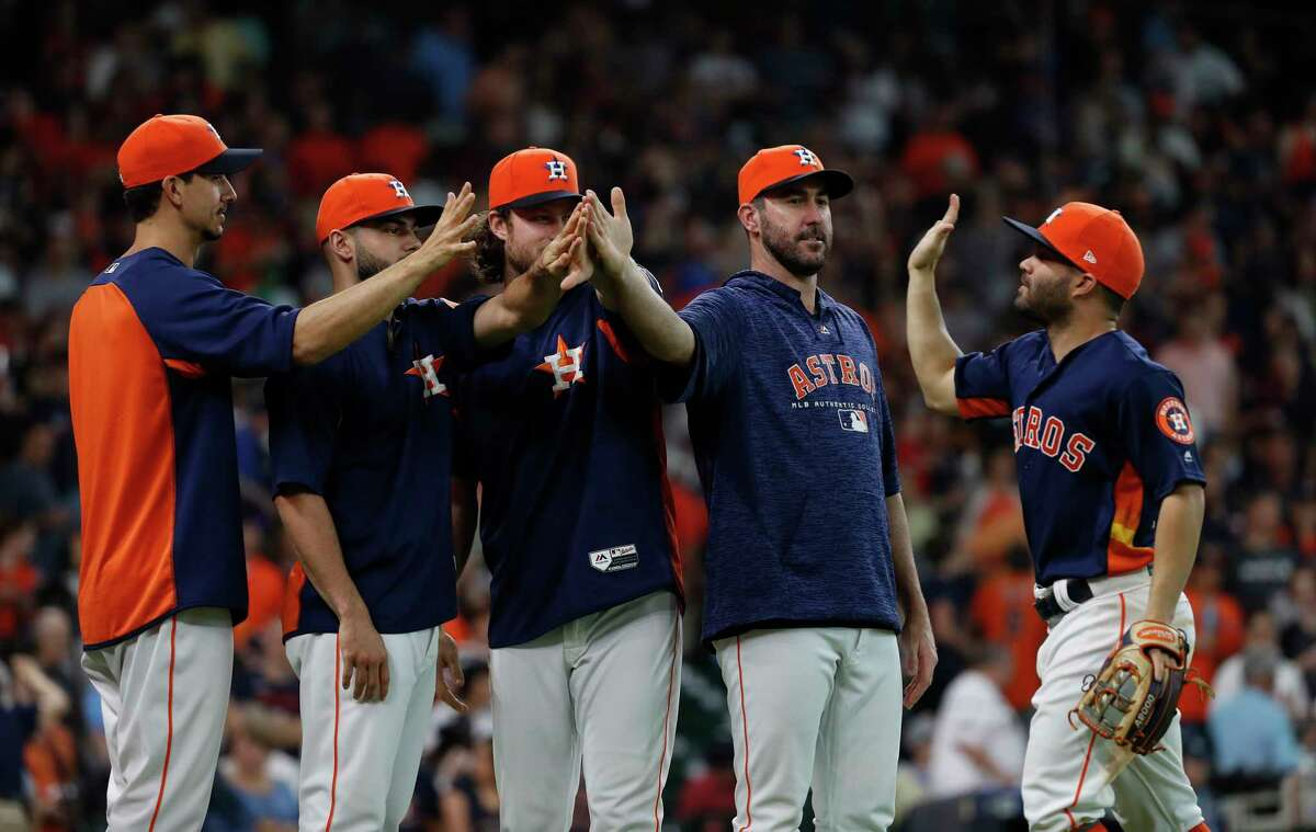 Houston Astros pitchers Justin Verlander, Gerrit Cole, Lance McCullers Jr., and Charlie Morton celebrate the Astros win over Chicago White Sox with Jose Altuve after an MLB game at Minute Maid Park, Sunday, July 8, 2018, in Houston.
