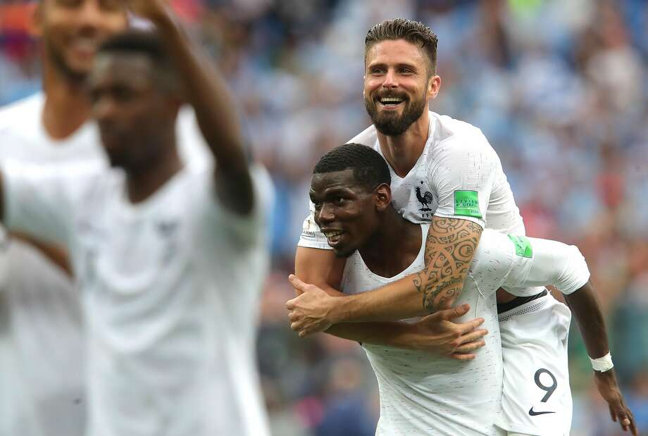 France's Paul Pogba and Olivier Giroud (top) celebrate after beating Uruguay 2-0 in their World Cup quarterfinal match Friday in Nizhny Novgorod, Russia. Photo: Alexander Hassenstein / Getty Images