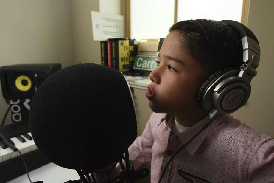 "Jacob Pichardo sings ""it's cool to come to school"" during a recording session with his father, Eric Pichardo, at Yes! Our Kids Can on Friday, July 6, 2018. Photo: Billy Calzada, Staff / San Antonio Express-News / San Antonio Express-News"