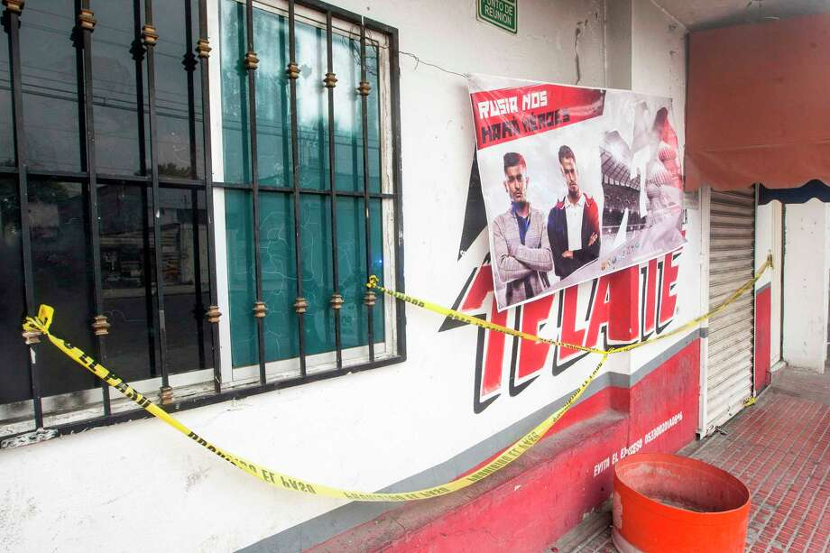 Front view of the bar where people were murdered at dawn in a simultaneous attack in Monterrey, Nuevo Leon, Mexico on July 8, 2018. At least 12 people died in a serie of armed attacks to different bars and night clubs during the night of July 7 and July 8 dawn. / AFP PHOTO / Julio Cesar AGUILARJULIO CESAR AGUILAR/AFP/Getty Images Photo: JULIO CESAR AGUILAR, AFP/Getty Images / AFP or licensors