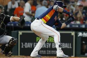Houston Astros Marwin Gonzalez lays down a sacrifice bunt allowing Yuli Gurriel to score a run during the seventh inning of an MLB game at Minute Maid Park, Sunday, July 8, 2018, in Houston. ( Karen Warren  / Houston Chronicle )
