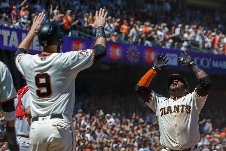 Pablo Sandoval is greeted by Brandon Belt (9) at the plate after Sandoval launched a three-run homer to right. The Giants' third baseman went 3-for-5 with five RBIs. Photo: Jason O. Watson / Getty Images