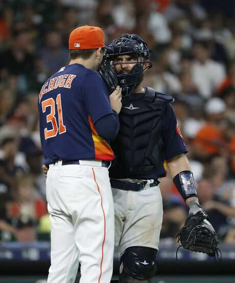 Houston Astros relief pitcher Collin McHugh (31) chats with catcher Max Stassi (12) during the eighth inning of an MLB game at Minute Maid Park, Sunday, July 8, 2018, in Houston. ( Karen Warren  / Houston Chronicle ) Photo: Karen Warren/Houston Chronicle