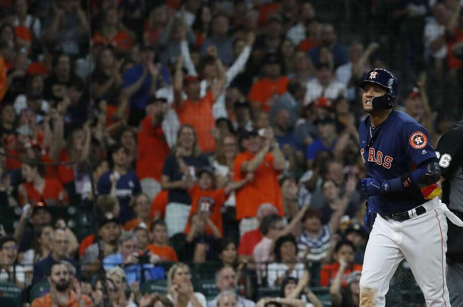 Houston Astros Yuli Gurriel (10) scores a run on a sarifice bunt by Houston Astros Marwin Gonzalez during the seventh inning of an MLB game at Minute Maid Park, Sunday, July 8, 2018, in Houston. ( Karen Warren  / Houston Chronicle ) Photo: Karen Warren/Houston Chronicle
