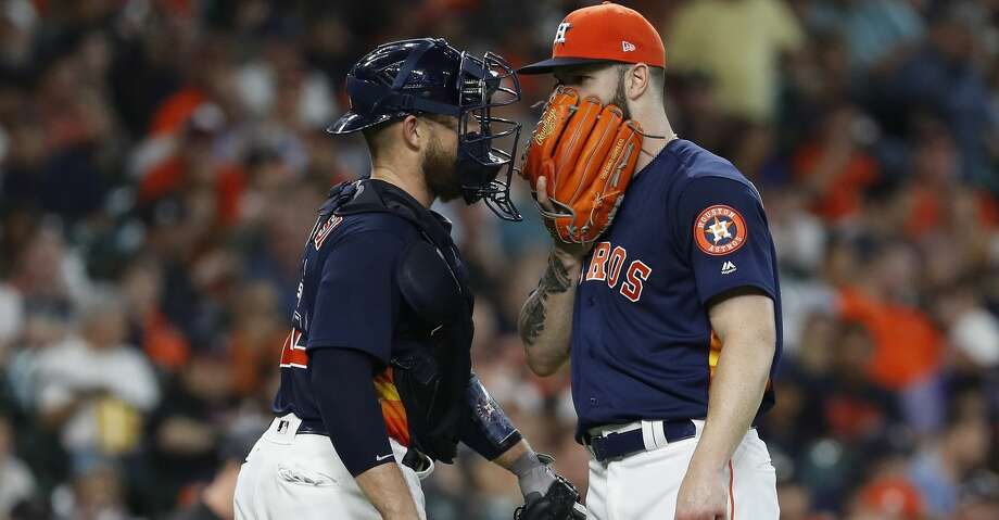 Houston Astros starting pitcher Dallas Keuchel (60) chats with catcher Max Stassi (12) during the second inning of an MLB game at Minute Maid Park, Sunday, July 8, 2018, in Houston. ( Karen Warren  / Houston Chronicle ) Photo: Karen Warren/Houston Chronicle