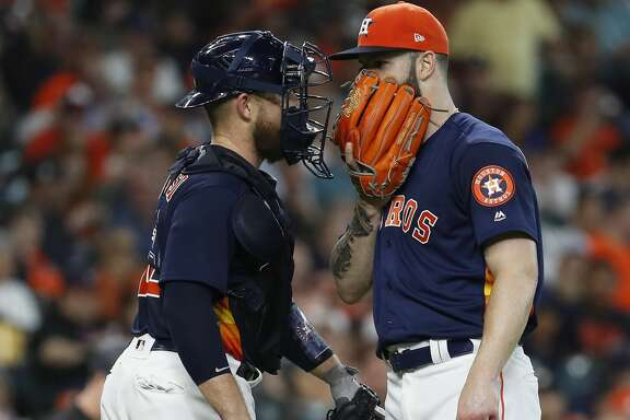 Houston Astros starting pitcher Dallas Keuchel (60) chats with catcher Max Stassi (12) during the second inning of an MLB game at Minute Maid Park, Sunday, July 8, 2018, in Houston. ( Karen Warren  / Houston Chronicle )